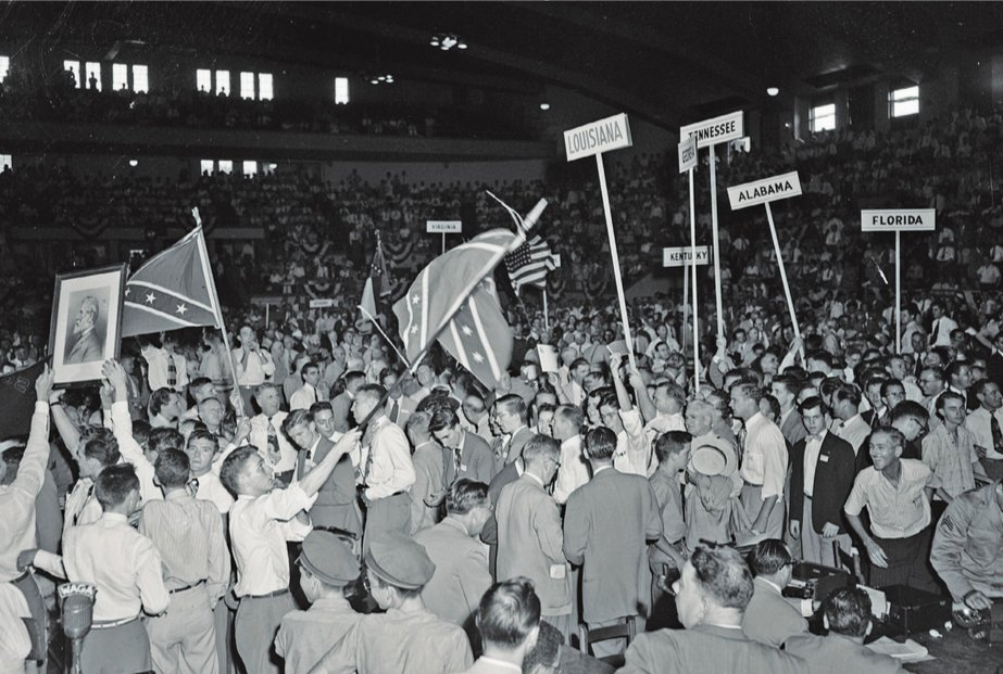 Southern delgaates to the Dixiecrats' 1948 Party Convention in Birmingham, ALabama proudly wave the Confederate flag.