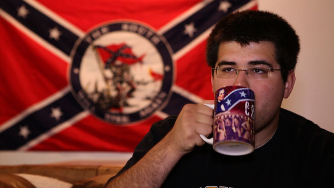 Mathhew Heimbach, founder of the Traditionalist Youth Network, takes  sip from a mug emblazoned with the visage of Confederate President Jefferson Davis...who preferred his coffee VERY white.