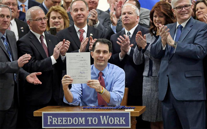 Scott Walker proudly demonstrates his selling of Wisconsin to Koch Industries.