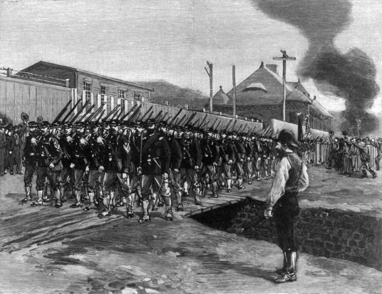 The Pennsylvania state militia lines up to attack striking workers at Carnegie Steel's Homestead works in 1892. All in the name of freedom, of course.