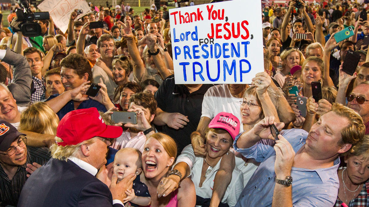 Donald Trump greets a mob of deranged Middle-American radcials in Alabama, a state where crazy is a prerequisite for political office.