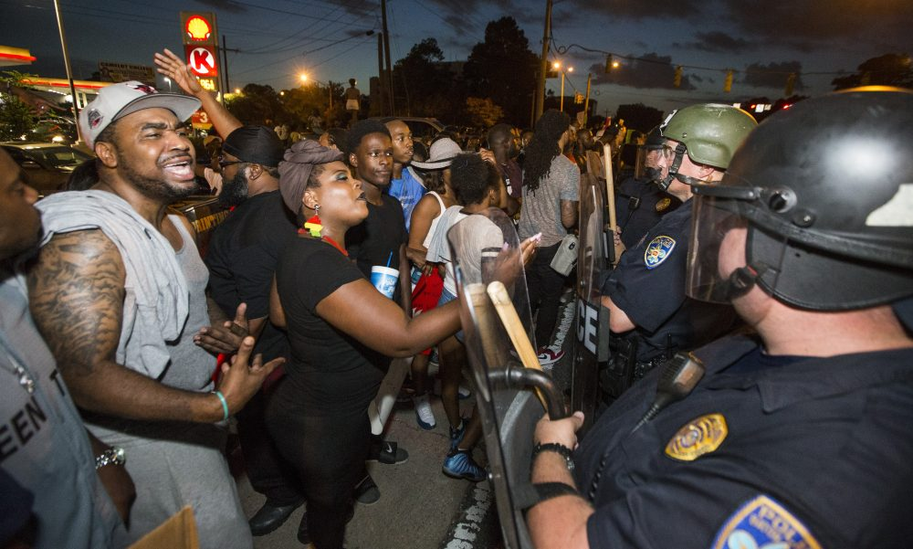 Protestors face off against Baton Rouge's heavily militarized poice force folowing the shooting of Alton Sterling.