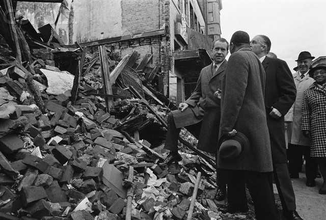 President Richard Nixon, Rev. Martin Luther King, and Governor George Romney (Mitt's father) visit the aftermath of a riot scene in Detorit, 1968.