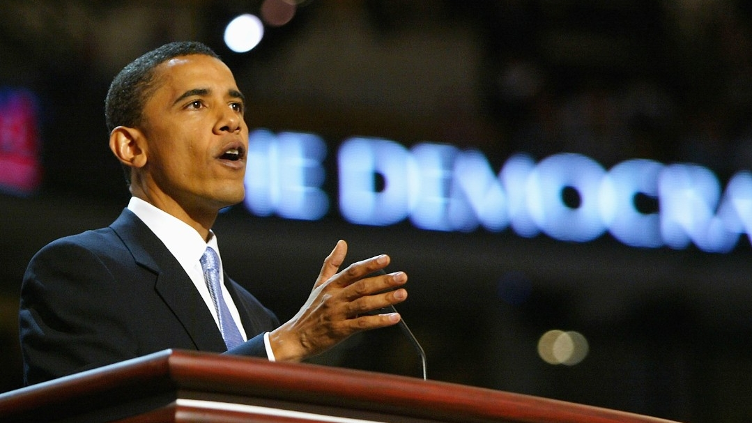 Future President Barack Obama speeking at the 2004 Democraticv National Convention, before American divisiveness turned his hhair gray.