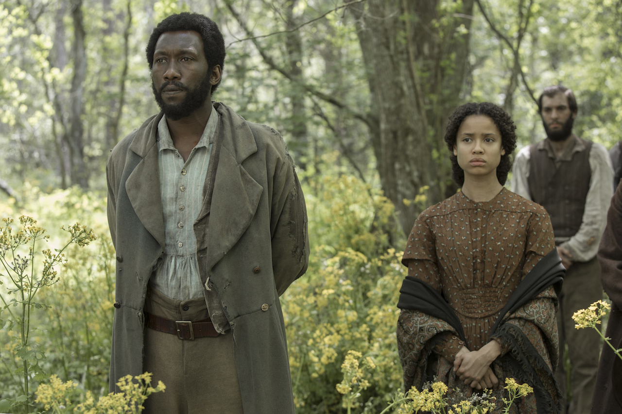 Moses (Mahershala Ali) and Rachel (Gugu Mbatha-Raw) hide out as runaway slaves in the Mississippi swamps.