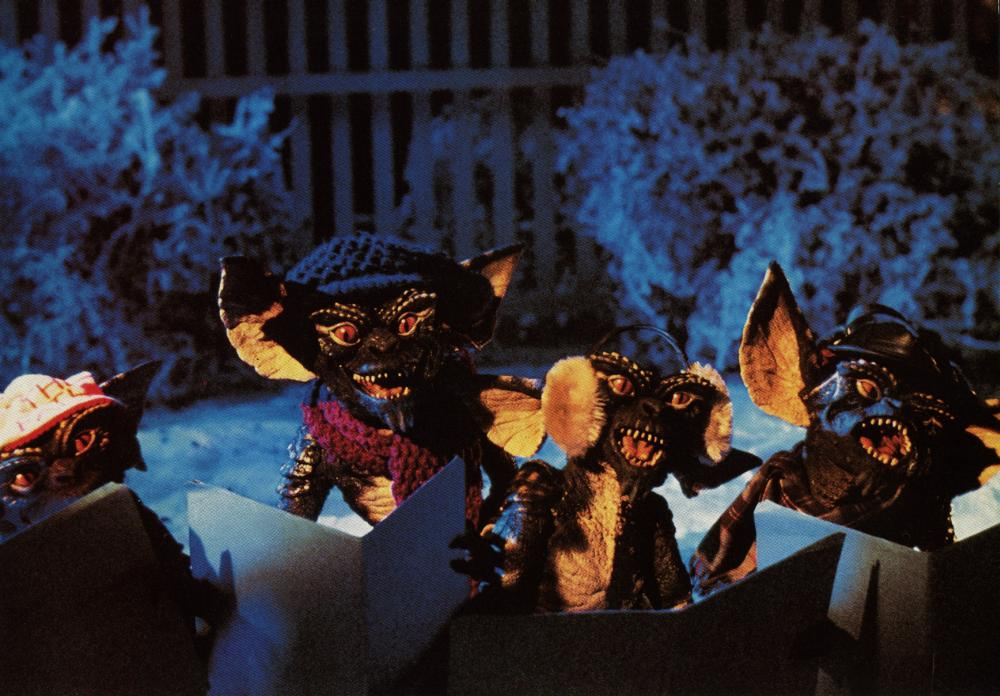 The creepy, nefarious Gremlins sing Christmas carols in the suburbs.